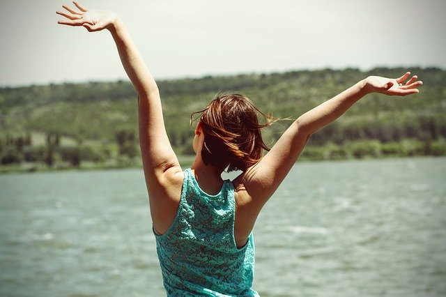 Happy person with arms in the air