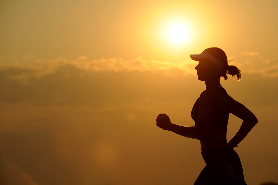 Woman jogging in the sunset